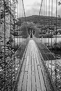 Sappers suspension bridge over the River Conwy built in 1930 and a prominent landmark in the village of Betws-y-Coed in North Wales. In Black and White