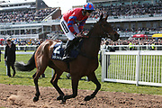 Clondaw Castle ridden by Ciaran Gethigs head for he start of the  3.00pm The Doom Bar Maghull Novices' Steeple Chase (Grade 1) 2m during the Grand National Meeting at Aintree, Liverpool, United Kingdom on 6 April 2019.