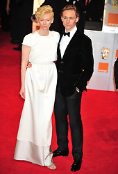 © Licensed to London News Pictures. 12/02/2012. London, England.Tilda Swinton and Tom Hiddleston arrives for the Orange British Academy Film Awards at The Royal Opera House on February 12, 2012 in London, England. Photo credit : ALAN ROXBOROUGH/LNP