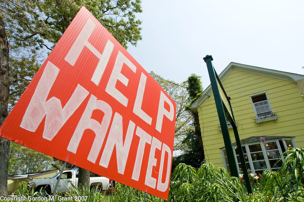 Amagansett, NY - 5/26/07 - Help Wanted sign in front of C. Whitmore Gardens on Montauk Highway in Amagansett, NY May 26, 2007.  Many business's on the east end are still looking for seasonal employee's.(Photo by Gordon M. Grant)