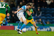 Sam Gallagher of Blackburn Rovers  shields the ball from Joe Rafferty of Preston North End  during the EFL Sky Bet Championship match between Blackburn Rovers and Preston North End at Ewood Park, Blackburn, England on 11 January 2020.