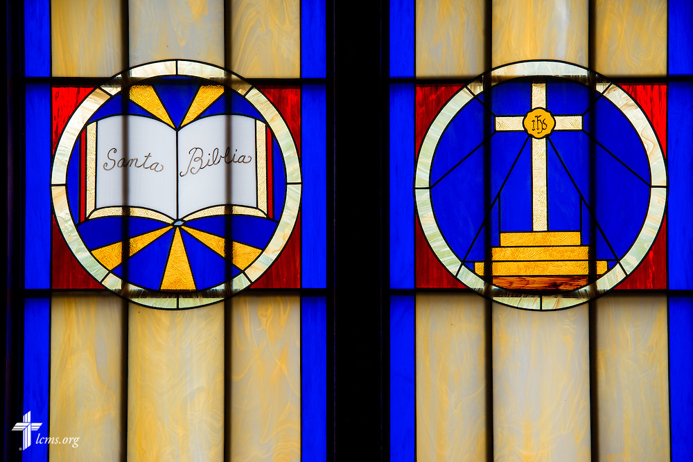 Stained glass at El Calvario Lutheran Church depicts the Bible and the altar cross on Sunday, April 17, 2016, in Brownsville, Texas. LCMS Communications/Erik M. Lunsford