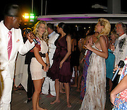 **EXCLUSIVE**.Boris Becker's wife Lilly Kerssenberg dancing (brown dress), Hermann Bühlbecker, Lambertz Chocolate owner (white shirt)..Denise Rich Annual Summer Party..Lady Joy Yacht..Port of St Tropez..St Tropez, France..Thursday, July 30, 2009..Photo By Celebrityvibe.com.To license this image please call (212) 410 5354; or Email: celebrityvibe@gmail.com ; .website: www.celebrityvibe.com.
