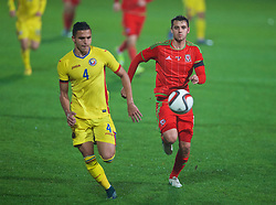 WREXHAM, WALES - Tuesday, November 17, 2015: Wales' Thomas O'Sullivan in action against Romania's Cristian Manea during the UEFA Under-21 Championship Qualifying Group 5 match at the Racecourse Ground. (Pic by David Rawcliffe/Propaganda)
