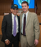 Dr. Andrew Houlihan, right, recognizes Thurgood Marshall Elementary School principal Hilarion Martinez, left, during a principal meeting, April 9, 2014. Martinez was named Elementary School Principal of the Year.