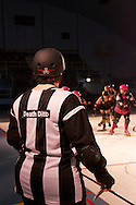 Referee Death Ditto watches the game at the C-Max Roller Derby league Deathrow Demolition Derby, July 28 2012. The Raging Whoremones versus the Thundering Hellcats, Johannesburg, South Africa.