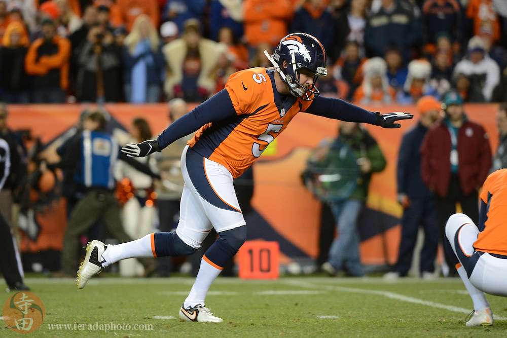 November 17, 2013; Denver, CO, USA; Denver Broncos kicker Matt Prater (5) kicks a point-after-touchdown during the first quarter against the Kansas City Chiefs at Sports Authority Field at Mile High. The Broncos defeated the Chiefs 27-17.