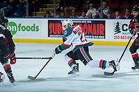 KELOWNA, CANADA - FEBRUARY 20: Colum McGauley #23 of the Kelowna Rockets trips and loses the puck while skating against the Prince George Cougars  on February 20, 2018 at Prospera Place in Kelowna, British Columbia, Canada.  (Photo by Marissa Baecker/Shoot the Breeze)  *** Local Caption ***