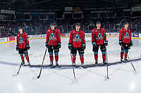 KELOWNA, CANADA - MARCH 16: Michael Farren #16, Mark Liwiski #9, Liam Kindree #26, Devin Steffler #4 and Schael Higson #21 of the Kelowna Rockets stand on the blue line at the start of the game against the Vancouver Giants on March 16, 2019 at Prospera Place in Kelowna, British Columbia, Canada.  (Photo by Marissa Baecker/Shoot the Breeze)