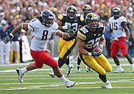 September 19, 2009: Iowa wide receiver Colin Sandeman (22) pulls in a pass as Arizona linebacker Vuna Tuihalamaka (8) tries to catch up during the Iowa Hawkeyes' 27-17 win over the Arizona Wildcats at Kinnick Stadium in Iowa City, Iowa on September 19, 2009.