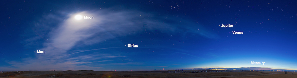 A 5-segment panorama of the evening sky, March 4, 2012, with four planets across the sky, from (right to left, west to east): Mercury (in bright twilight), then Venus and Jupiter (bright in southwest) then the Moon (in clouds in the southeast) then Mars rising in the east just to the left of the clouds. Mercury was near greatest eastern elongation (March 5) and Mars was near opposition (March 3). Each segment is a 13-second exposure at f/4 and ISO 400 with the 16-35mm lens at 19mm and Canon 5D MkII. Taken from near home in southern Alberta.