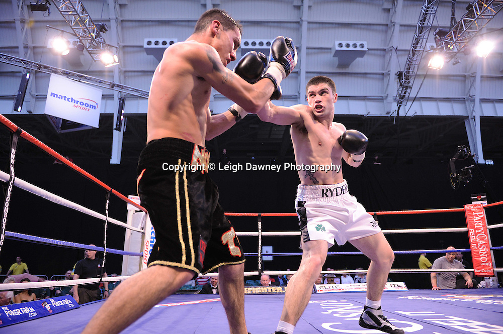 John Ryder (white shorts) defeats Lee Noble at London's Olympia on Saturday 30th April 2011. Matchroom Sport. Photo credit © Leigh Dawney.