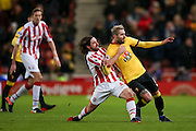 Stoke City midfielder Joe Allen (4)  and Watford midfielder Valon Behrami (11) tangle in the middle of the park during the Premier League match between Stoke City and Watford at the Britannia Stadium, Stoke-on-Trent, England on 3 January 2017. Photo by Simon Davies.