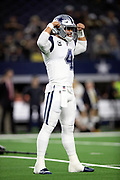 Dallas Cowboys quarterback Dak Prescott (4) flexes his biceps and grimaces during the NFL week 13 regular season football game against the New Orleans Saints on Thursday, Nov. 29, 2018 in Arlington, Tex. The Cowboys won the game 13-10. (©Paul Anthony Spinelli)
