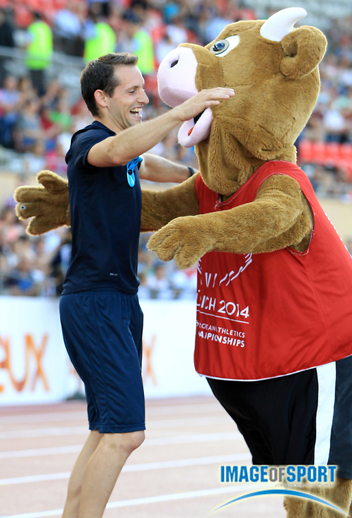 Jul 3, 2014; Lausanne, SWITZERLAND; Renaud Lavillenie (FRA) is embraced by the 2014 European Athletics championships mascot at the 2014 Athletissima at Stade Olympique de la Pontaise. Photo by Jean-Pierre Durand