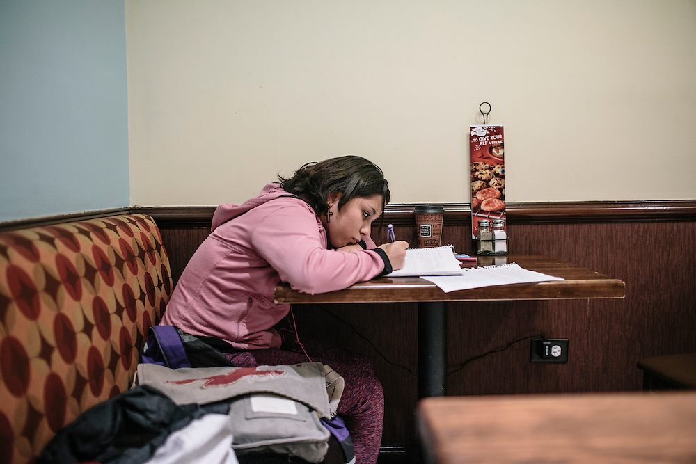 "Daniela Shia-Sevilla, 15, works on homework from a quiet area in The Corner Bakery in downtown DC, across from the hotel her mom works at. ""I have so many assignments, I don't get the chance to write for me unless it's for a competition,"" Shia-Sevilla said."