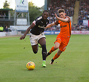 August 9th 2017, Dens Park, Dundee, Scotland; Scottish League Cup Second Round; Dundee versus Dundee United; Dundee's Roarie Deacon races past Dundee United's Jamie Robson