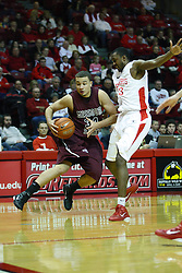 12 February 2011: Kyle Weems cuts the corner and beats Justin Clark during an NCAA Missouri Valley Conference basketball game between the Missouri State Bears and the Illinois State Redbirds at Redbird Arena in Normal Illinois.