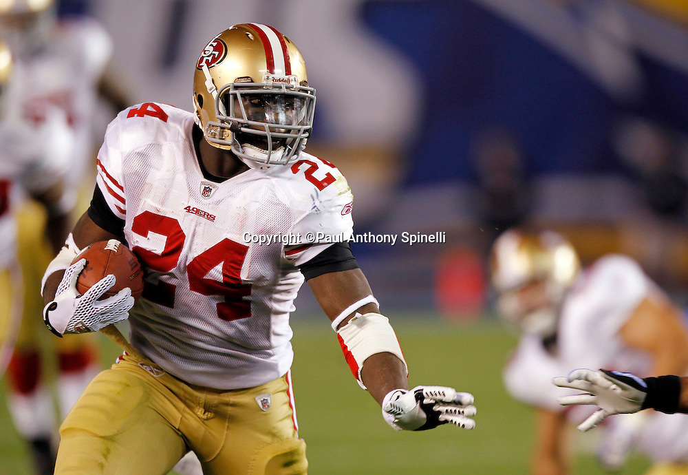 San Francisco 49ers running back Anthony Dixon (24) runs the ball during the NFL week 15 football game against the San Diego Chargers on Thursday, December 16, 2010 in San Diego, California. The Chargers won the game 34-7. (©Paul Anthony Spinelli)