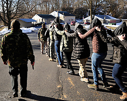 Students participate in a mock kidnapping scenario with theatrical explosions and simulated gunfire as part of the Hostile Environments First Aid Training course on Monday, March 23rd 2015 in Hellertown, Pa. Photo By | CHRIS POST