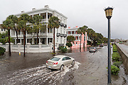 Cars pass stately homes in floodwater along the Battery in the historic district as Hurricane Joaquin brings heavy rain, flooding and strong winds as it passes offshore October 4, 2015 in Charleston, South Carolina.