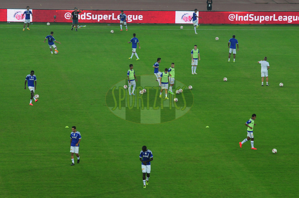 NorthEast United FC players warm up before match 16 of the Hero Indian Super League between The Delhi Dynamos FC and NorthEast United FC held at the Jawaharlal Nehru Stadium, Delhi, India on the 29th October 2014.<br /> <br /> Photo by:  Arjun Panwar/ ISL/ SPORTZPICS