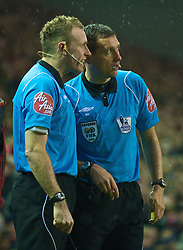 LIVERPOOL, ENGLAND - Saturday, December 26, 2009: Referee confers with his assistant after mistakenly booking Wolverhampton Wanderers' Christophe Berra instead of Stephen Ward, who had committed the foul. This lead to Ward's second Yellow Card, and therefore a red during the Premiership match at Anfield. (Photo by: David Rawcliffe/Propaganda)