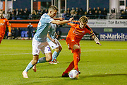 Accrington Stanley midfielder Daniel Barlaser on loan from Newcastle (26) tries to tackle Luton Town defender Glen Rea (16) during the EFL Sky Bet League 1 match between Luton Town and Accrington Stanley at Kenilworth Road, Luton, England on 23 October 2018.