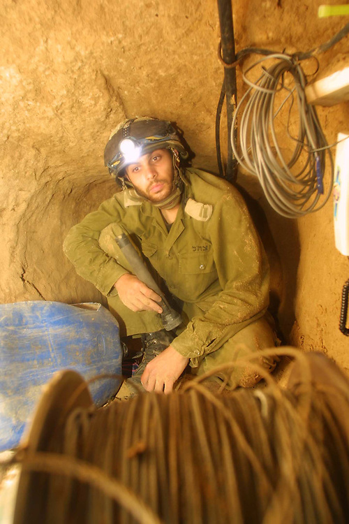 ..Israeli forces on operations in Han ?Unes refuge camp near by the Philadelphi Road to fined tunnels that smugglings weapon to the Gaza strip  the..1 of the tunnel that was discover by the special forces...In the tunnel: Aviv Hakyniy commander of the tunnel unit that death in the 12 of may 2004 attack on the Philadelphi Road  .