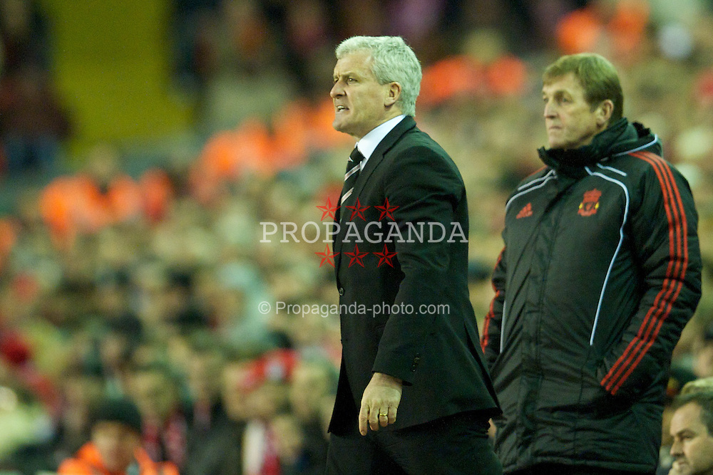 LIVERPOOL, ENGLAND - Wednesday, January 26, 2011: Fulham's manager Mark Hughes and Liverpool's manager Kenny Dalglish MBE during the Premiership match at Anfield. (Photo by: David Rawcliffe/Propaganda)