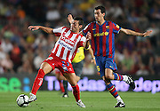 Sporting de Gijon's David Barral (l) and FC Barcelona's Sergio Busquets during  La Liga match.August 31 2009.