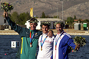 20040828 Olympic Games Athens Greece .[Canoe/Kakak Flatwater Racing] .Lake Schinias - Saturday Finals day.left AUS Silver medallist Nathan Baggerley, centre Gold medallist CAN Adam van Koeverden  right GBR Bronze medallist  Ian Wynne...Photo  Peter Spurrier.email images@intersport-images.com...