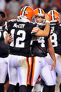 Sept. 2, 2010; Cleveland, OH, USA; Cleveland Browns quarterback Colt McCoy (12) celebrates with place kicker Phil Dawson (4) after Dawson kicked the game winning filed goal during the final seconds  of the fourth quarter against the Chicago Bears at Cleveland Browns Stadium. The Cleveland Browns beat the Chicago Bears 13-10. Mandatory Credit: Jason Miller-US PRESSWIRE