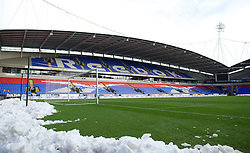 BOLTON, ENGLAND - Saturday, January 26, 2013: Snow cleared from the pitch mounts up at Bolton Wanderers' Reebok Stadium ahead of the FA Cup 4th Round match against Everton. (Pic by David Rawcliffe/Propaganda)