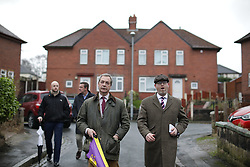 © Licensed to London News Pictures . 03/02/2017. Stoke-on-Trent, UK . Former UKIP leader Nigel Farage joins current leader Paul Nuttall canvassing in Newhouse Road , during Nuttall's campaign to win the seat of Stoke-on-Trent Central . Photo credit: Joel Goodman/LNP