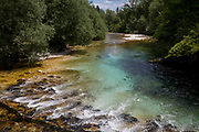 Clear mountain waters of the Savica river at Ucanc near Lake Bohinj, on 19th June, in Lake Bohinj, Sovenia.
