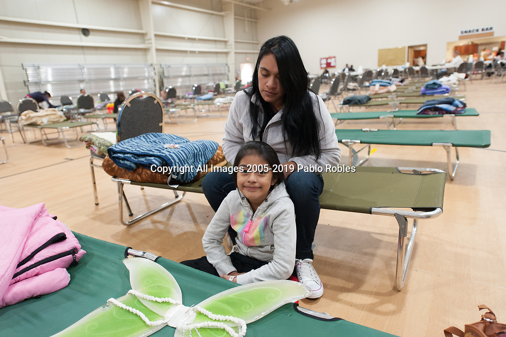 Glendy Aguilar and daughter Ashley Aguilar 6 years old, refugees from Huehuetenango Guatemala wait to be transported to the Greyhound bus station in Phoenix after being dropped off by Immigration and Customs Enforcements (ICE) and spending the night at the First Southern Baptist Church of Avondale, AZ. on Thursday December 27, 2018.