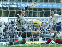 13/11/2004 - FA Barclays Premiership - Tottenham Hotspur v Arsenal - White Hart Lane<br />Tottenham's Noureddine Naybet scores the opening goal past Arsenal's diving goalkeeper Jens Lehmann<br />Photo:Jed Leicester/Back page images