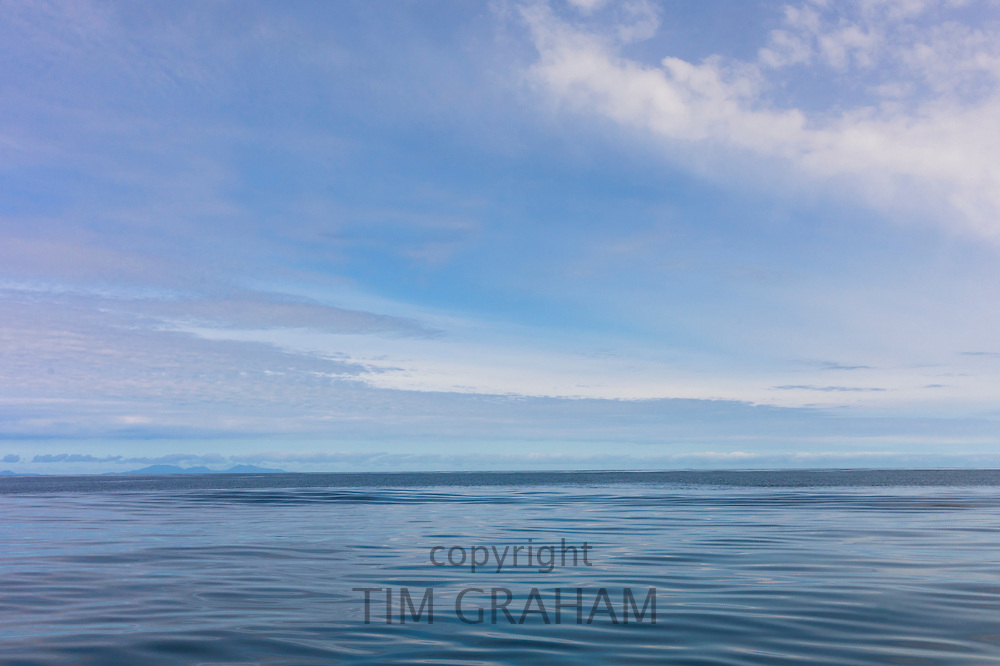 Pastel blue shades of tranquil calm waters of sea and sky scene, Isle of Skye, Scotland