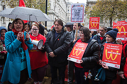 London, UK. 12 November, 2019. Frances O'Grady, General Secretary of the Trades Union Congress (TUC), addresses McDonald's workers belonging to the Bakers Food and Allied Workers Union assembled opposite Downing Street during strike action, dubbed a 'McStrike', to call for a New Deal for McDonald's Workers which would include £15 an hour, an end to youth rates, the choice of guaranteed hours of up to 40 hours a week, notice of shifts four weeks in advance and union recognition.