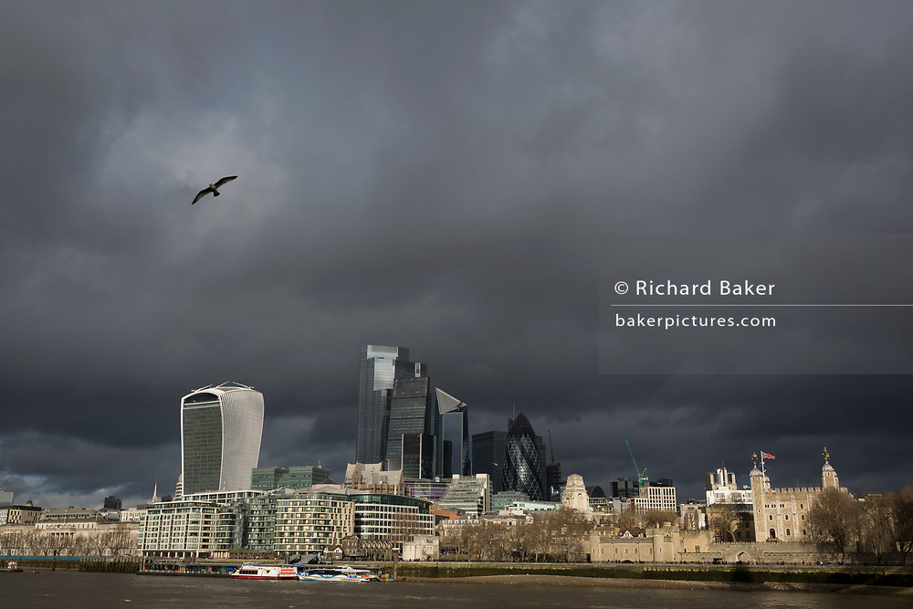 Weeks before the UK's Brexit from the European Union (on 31st January 2020), a wide cityscape of the Tower of London (far right) and the City of London, the capital's financial district, under a darkening sky, on 17th January 2020, in London, England.