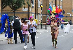 © Licensed to London News Pictures. 27/08/2012 London, England. Notting Hill Carnival 2012, the largest street festival in Europe, gets its parade on Adults' Day under way. Photo credit: Bettina Strenske/LNP