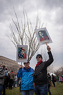 Two opponents of President-Elect Trump hold signs the morning of the Presidential Inauguration.<br /> <br /> (Washington DC - January 20, 2017)