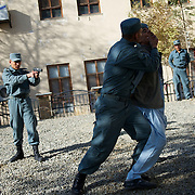 November 14, 2012 - Kabul, Afghanistan: Afghan National Police (ANP) cadets simulate the arrest of a Taliban during combat exercises at the Afghan Nacional Police Academy...ANP Academy trains 1250 cadets at the time during a period of four years. Every year, five hundred new recruits are selected, out of more than nine thousand of candidates, to join the academy and other five hundred graduate. Fifteen per cent of the recruits are women. (Paulo Nunes dos Santos/Polaris)