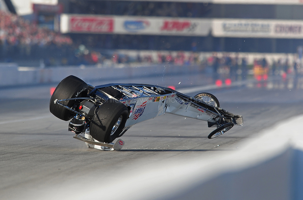 Feb. 13, 2010; Pomona, CA, USA; NHRA competition eliminator driver Tyler Hogan barrel rolls during qualifying at the Kragen O'Reilly Winternationals at Auto Club Raceway. Mandatory Credit: Jennifer Stewart-US PRESSWIRE