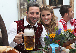 05.10.2014, Theresienwiese, München, GER, 1. FBL, FC Bayern Muenchen am Oktoberfest, im Bild Claudio Pizarro (L) of FC Bayern Muenchen and his wife Karla Salcedo attend the Oktoberfest 2014 beer festival at Kaefers Wiesenschaenke at Theresienwiese on 2014/10/05. EXPA Pictures © 2014, PhotoCredit: EXPA/ Eibner-Pressefoto/ Pool<br /> <br /> *****ATTENTION - OUT of GER*****