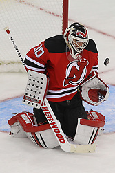 Jan 22, 2013; Newark, NJ, USA; New Jersey Devils goalie Martin Brodeur (30) makes a save during the second period at the Prudential Center.