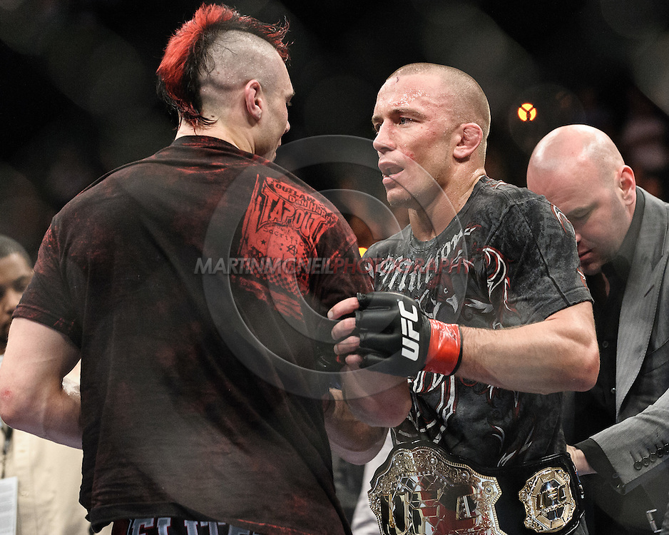 "NEWARK, NEW JERSEY, MARCH 27, 2010: Georges St. Pierre and Dan Hardy are pictured after their bout at ""UFC 111: St. Pierre vs. Hardy"" in the Prudential Center, New Jersey on March 27, 2010"