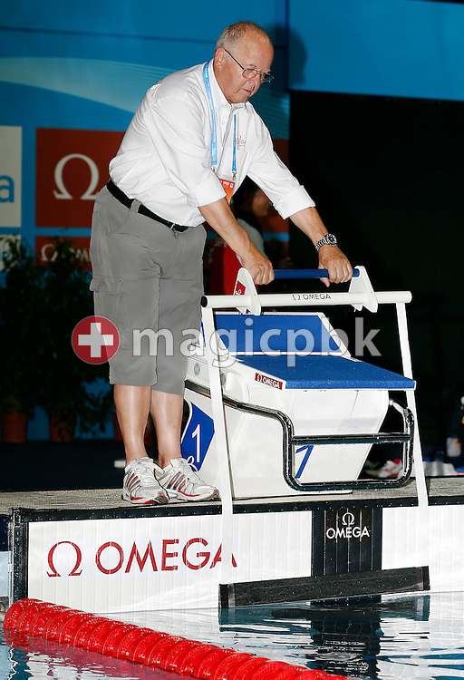 Peter Huerzeler of Swiss Timing LTD demonstrates the new OMEGA starting device for Backstroke swimming on a OMEGA OSB11 - starting block with relay break detection - is pictured during the 15th FINA World Aquatics Championships at the Palau Sant Jordi in Barcelona, Spain, Saturday, July 27, 2013. (Photo by Patrick B. Kraemer / MAGICPBK)