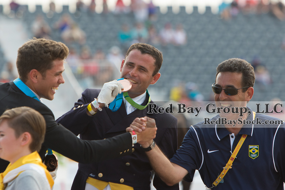 Brazilian Bronze Medal Dressage Team on the podium, Joao Victor Marcari Oliva, Joao Paulo Dos Santos and chef d'equipe Marcelo Vasconcellos at the OLG Caledon Pan Am Equestrian Park during the Toronto 2015 Pan American Games in Caledon, Ontario, Canada.
